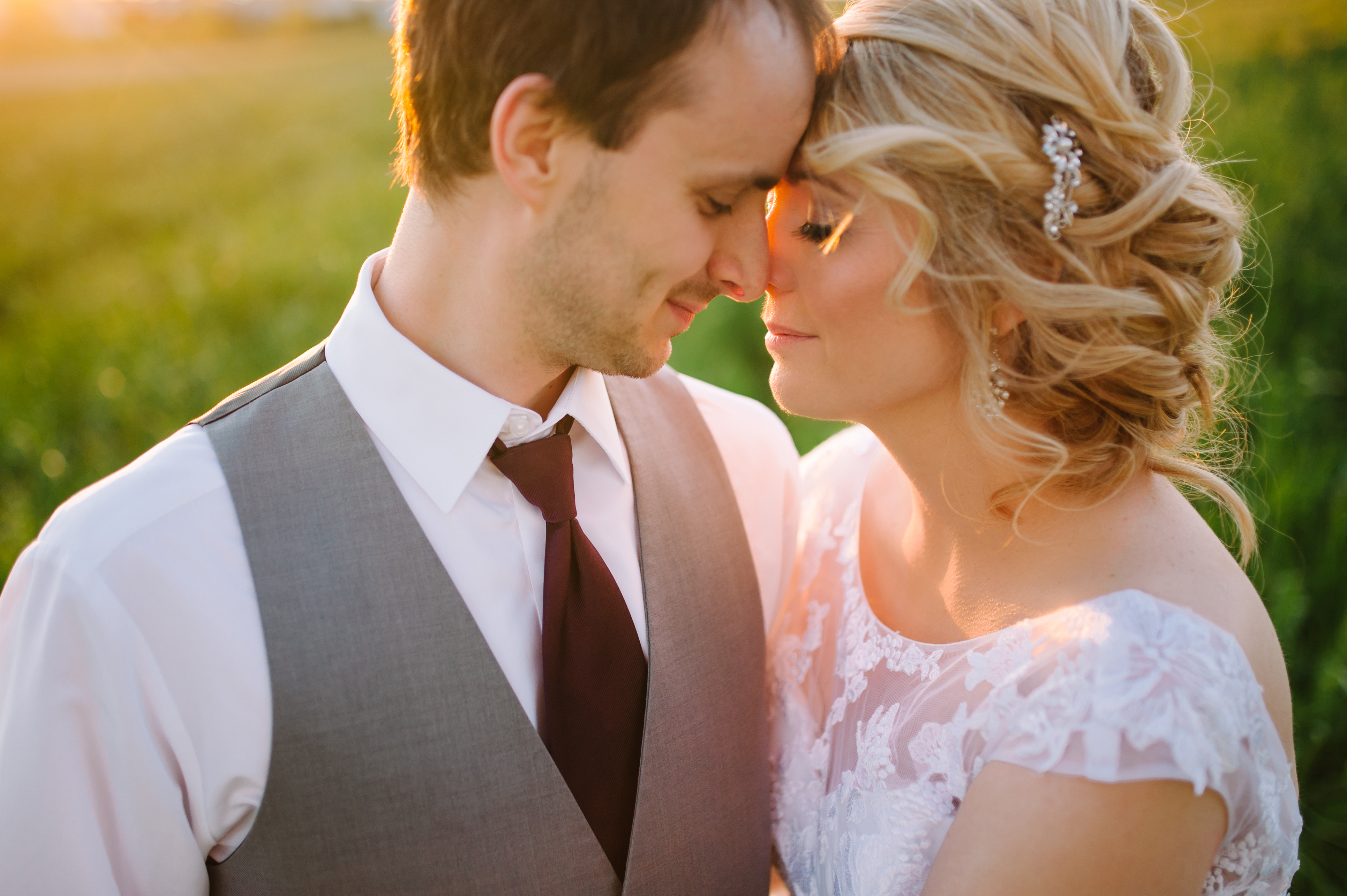 Sunset wedding photos taken by Stephanie Marie Photography in North Liberty, Iowa at South Slope Cooperative