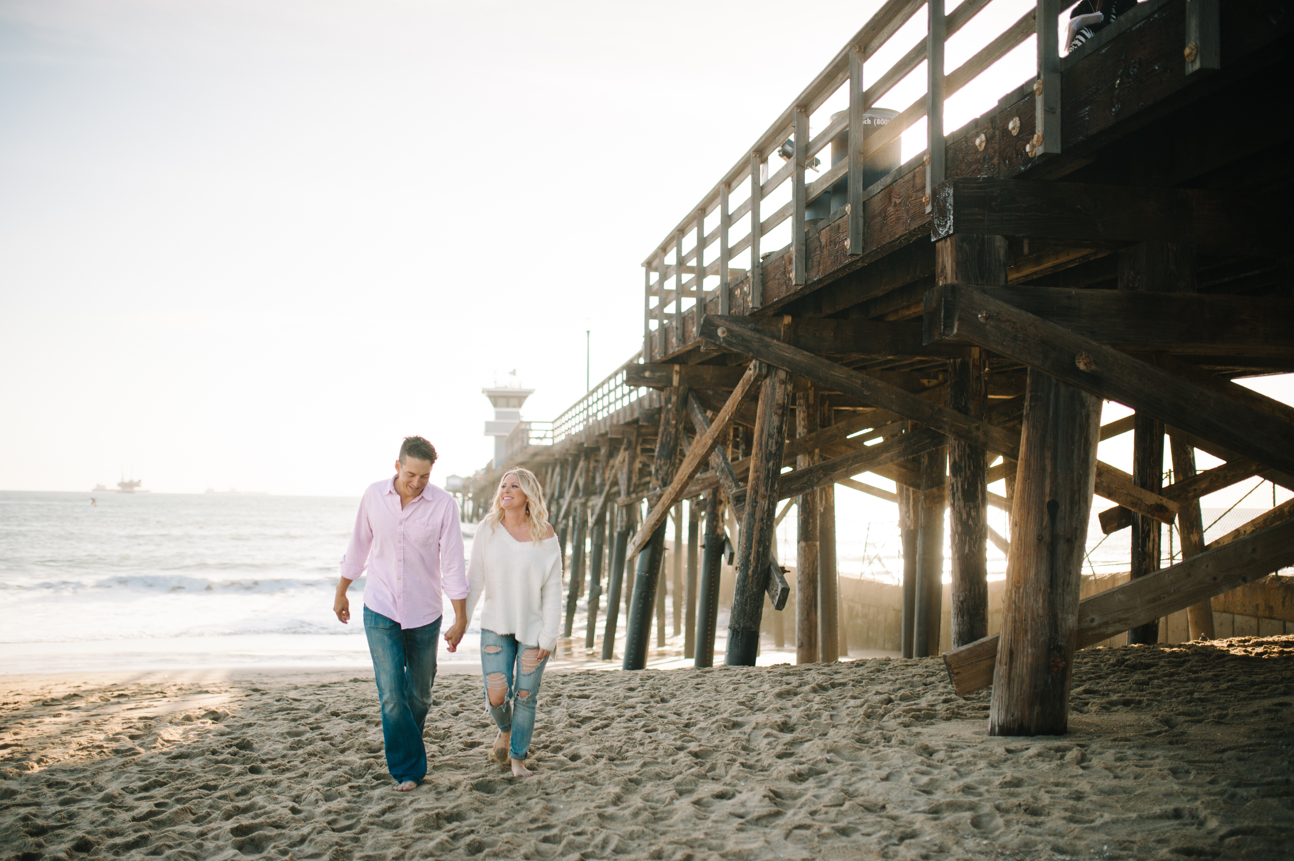 Los Angeles and San Diego engagement session with magazine model couple in Seal Beach at the Pier.